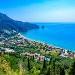 Agios Gordios Beach with crystal clear azure water and white beach in beautiful mountain landscape scenery – paradise coastline of Corfu island, Ionian archipelago, Greece.