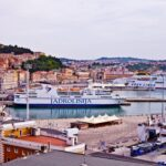 Ancona, Italy – June 8, 2019: The harbor of Ancona with cruise liner ships and boats docked and ancient city view.