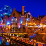 Night view of a restaurant alongside a water channel in the central Birmingham, England