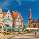 Bremen, Germany: View of the Central Square of Bremen with traditional Gothic architecture, cafe, restaurants and walking people. The famous German town, popular tourist destination
