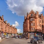 Glasgow, Scotland, Red Sandstone Tenements and Taxi Cab, Sunny Day