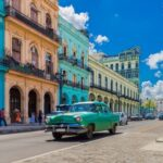 Cityscape with american green vintage car on the main street in Havana City Cuba – Serie Cuba Reportage