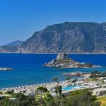 Beautiful beach with sea in tourist resort. Greece island Kos-Agios Stefanos. Beautiful concept for summer vacation. Natural colorful background.