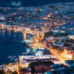 Kusadasi, Aydin Province, Turkey. Waterfront And Kusadasi Cityscape In Summer Evening. Night Scenic View Of Kusadasi Skyline At Aegean Coast, Turkey