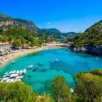 Agios Spiridon Beach with crystal clear azure water and white beach in beautiful landscape scenery – paradise coastline of Corfu island at Paleokastritsa, Ionian archipelago, Greece.