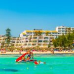 PORT D'ALCUDIA, SPAIN, MAY 25, 2017: Holiday resorts stretched alongside Alcudia beach on Mallorca, Spain