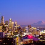 Seattle skyline at night with Mt Rainier in the distance