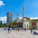 Group of tourists on Skanderbeg Square. Efem Bay Mosque, Clock Tower, Plaza Hotel, Tirana, Albania
