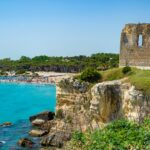 Holiday in Apulia. The bay of Torre dell'Orso, with its high cliffs, in Salento, Puglia, Italy.