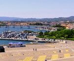 Olbia, Sardinia, Italy – Panoramic view of Olbia port and yacht marina with Citi hall in historic old town quarter